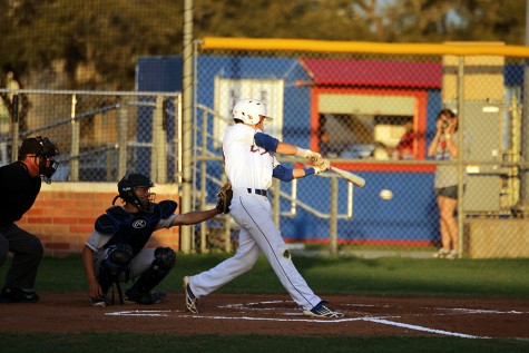 Senior Jason McCall hitting the ball against the Eagles. Jason McCall plays second base for the lions.