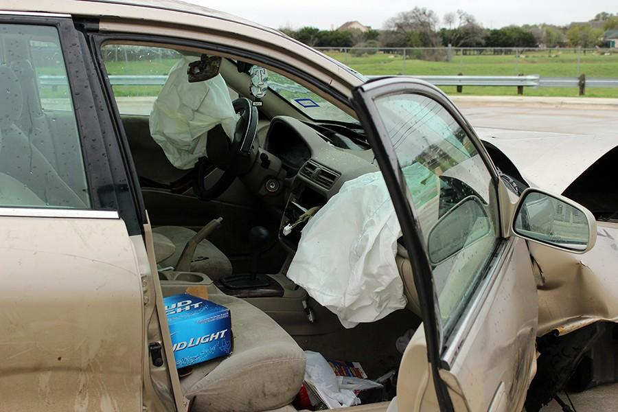 The inside of the car shows deflated airbags, and an empty beer box. The driver, took the last beer with him after the crash.
