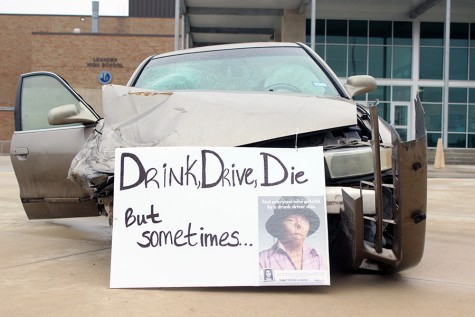 "At the front of the car it says ""Drink, Drive, Die"". It also features a victim of drunk driving on the side of the sign."