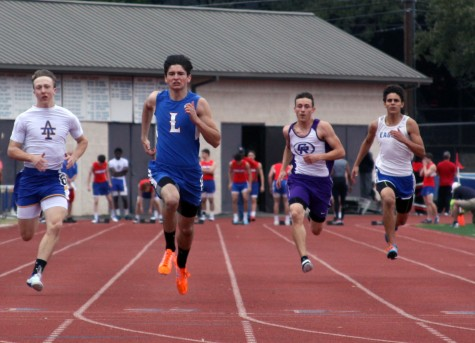 Sophomore Gavin Davis runs the 100 meter dash at Westlake. He won first in this race.