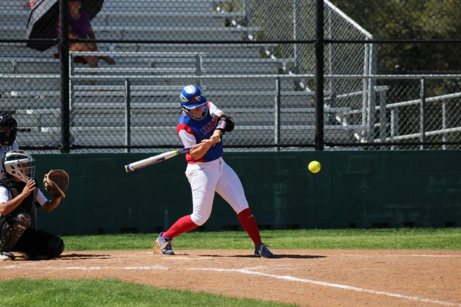 Senior Hailey MacKay about to hit the ball that would allow the Lady Lions to score. The Lady Lions won the game against Vandegrift 13-0.