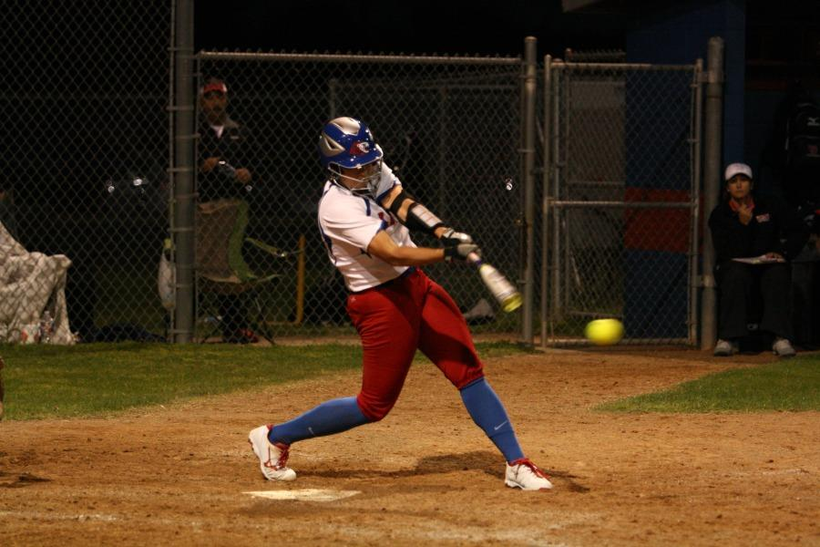 Senior Hailey MacKay hitting the ball against Vista Ridge. MacKay also had a few other hits during the game.
