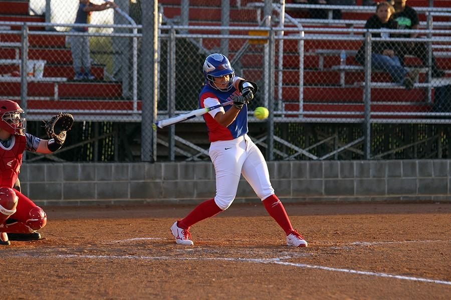 Senior Hailey MacKay hitting a double in the first inning.  Two doubles were hit in the game, one game by MacKay, and one hit by Haley Henderson.