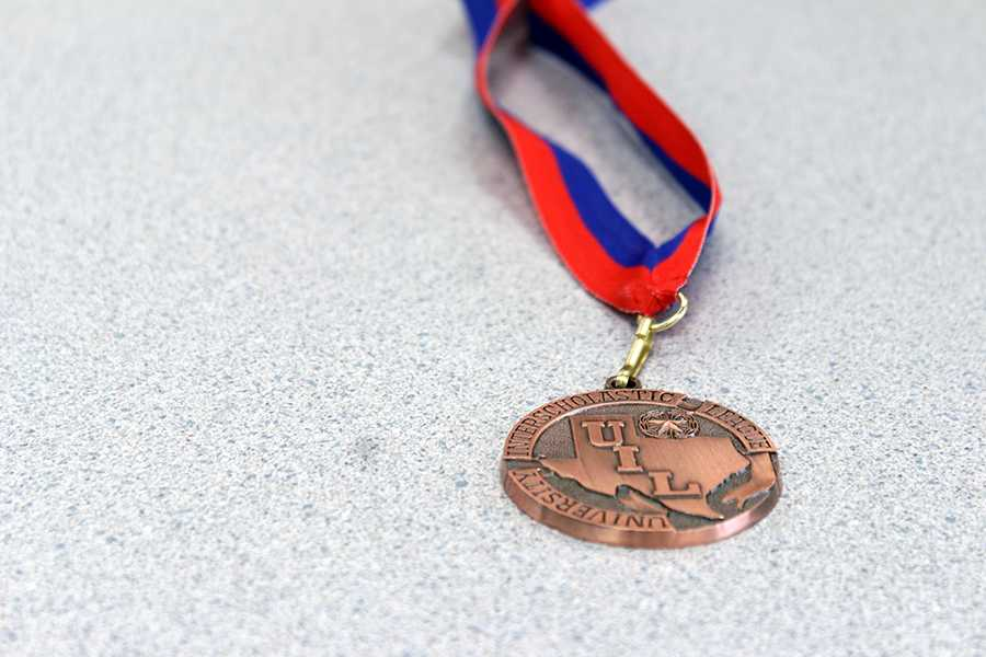 Senior Jack Densmore's third place medal from Hays. Senior Natalie Ditsler placed fifth in News Writing.