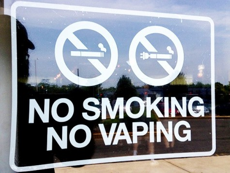 A sign disallowing use of cigarettes, including electronic cigarettes, in a public area. These signs have been popping up more and more as vaping grows.