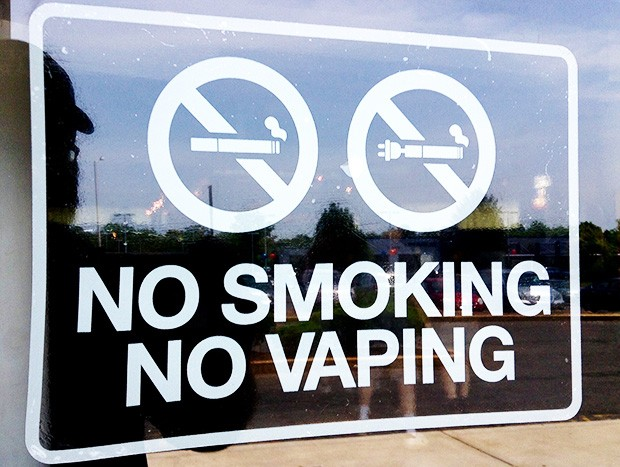 A+sign+disallowing+use+of+cigarettes%2C+including+electronic+cigarettes%2C+in+a+public+area.+These+signs+have+been+popping+up+more+and+more+as+vaping+grows.