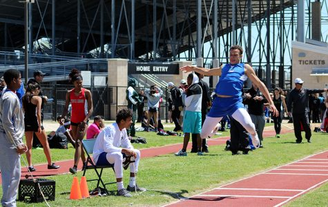 Sophomore Dalton Flowers competes in long jump. This was during the Lion Relays.