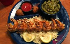 The above entree is the grilled shrimp which is $12.99. It comes with hush puppies, rice, green beans and cocktail sauce.