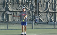 Senior Luis Farias getting ready to serve. He was with senior Joseph Rexroad and made it to the finals.