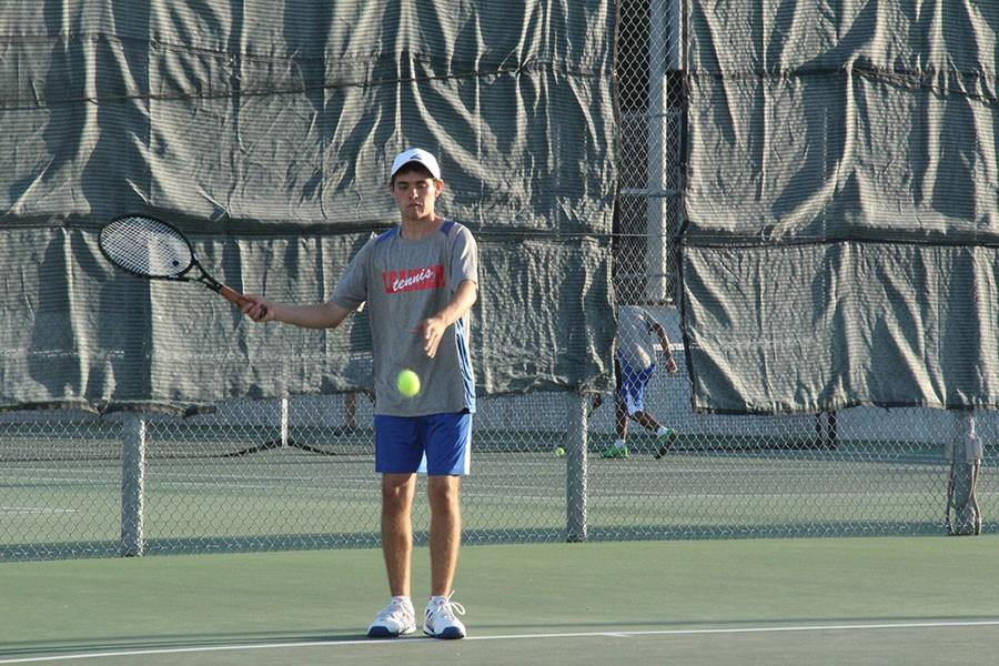 Senior+Luis+Farias+getting+ready+to+serve.+He+was+with+senior+Joseph+Rexroad+and+made+it+to+the+finals.