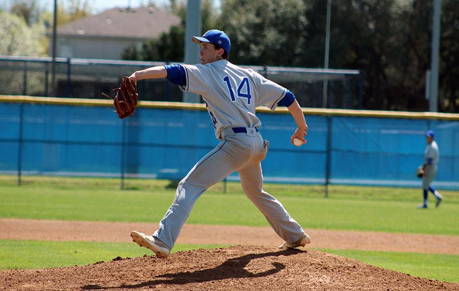 Jason McCall pitching against Saint Andrews. He also plays infield for the lions as well as DH.