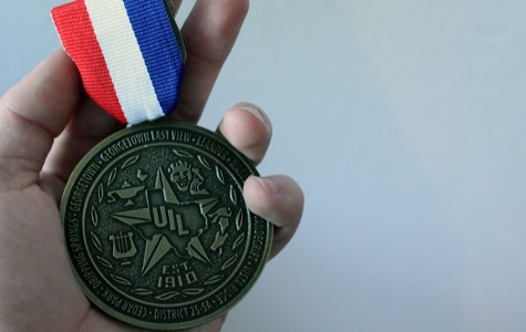 A first place medal won for first place in Editorial Writing. Thousands of UIL medals are received every year during the UIL season.