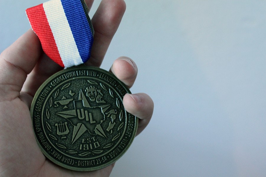 A+first+place+medal+won+for+first+place+in+Editorial+Writing.+Thousands+of+UIL+medals+are+received+every+year+during+the+UIL+season.