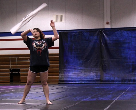 Senior Rachel Ellis practices for winter guard. They finished their last meet in second place.