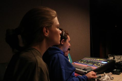 "Assistant Director Brooke Wetuski and sophomore manager Crimson Scott in the sound booth during the final late rehearsal before Mirage. ""I helped write a lot of Coach Anderson's script,"" Scott said. ""I had to make sure I know who's music goes to who and to make sure I got everything right for each specific night."""