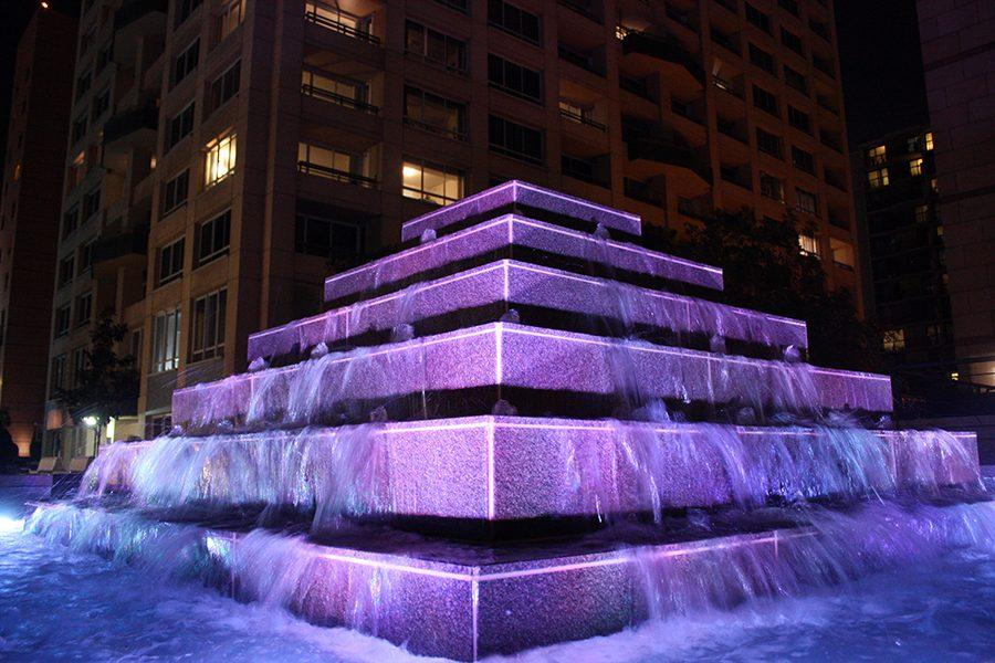 The fountain outside of the Omni hotel at night. The hotel was also next to a museum of art.