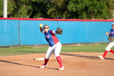 Senior Hailey MacKay throwing to first base. MacKay had one single hit in the game.