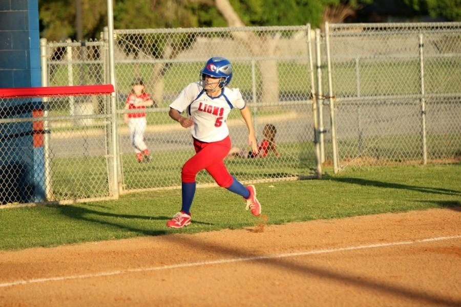 Senior Gabby Walton running towards home plate to score a run. Walton scored one run in the game.