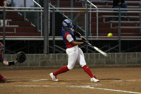Senior Hailey MacKay hitting the ball against East View. MacKay hit a dinger in the seventh inning against Vista Ridge to tie the game.