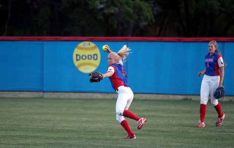 Senior Gabby Walton throwing from outfield against Cedar Park. Walton is one of the five seniors on the team.