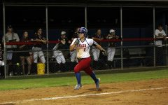 Freshman Haley Henderson running to home plate. Henderson also had a series of steals during the game.