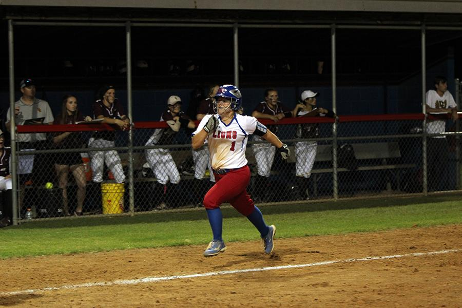 Freshman+Haley+Henderson+running+to+home+plate.+Henderson+also+had+a+series+of+steals+during+the+game.