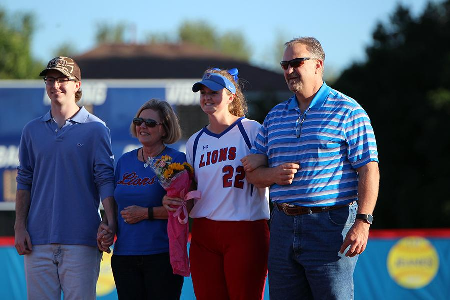 Senior+Ashley+Burgess+with+her+family.+Burgess+currently+plays+1B+for+senior+Kellie+Jeanes.