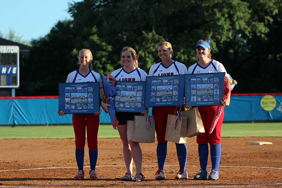 Seniors+Gabby+Walton%2C+Kellie+Jeanes%2C+Hailey+MacKay+and+Ashley+Burgess+standing+with+their+gifts+from+senior+night.