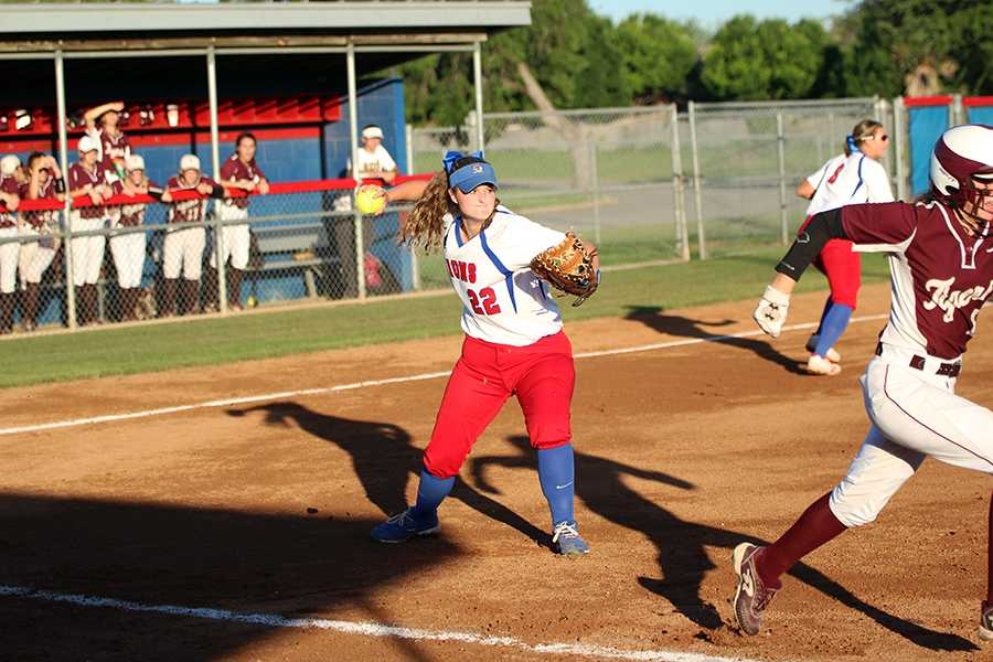 Senior+Ashley+Burgess+throwing+to+first+base+to+get+an+out.