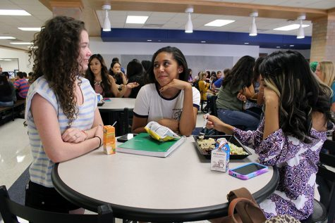 Students enjoy lunch in the cafe area.
