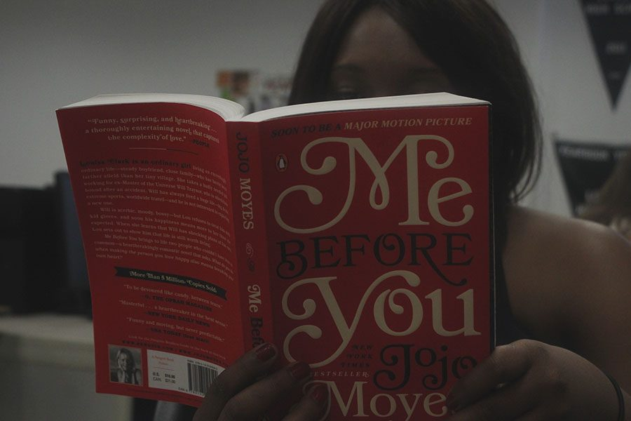 Student+reads+%22Me+Before+You%22+in+class.+The+sequel+to+the+book+was+released+in+2015.