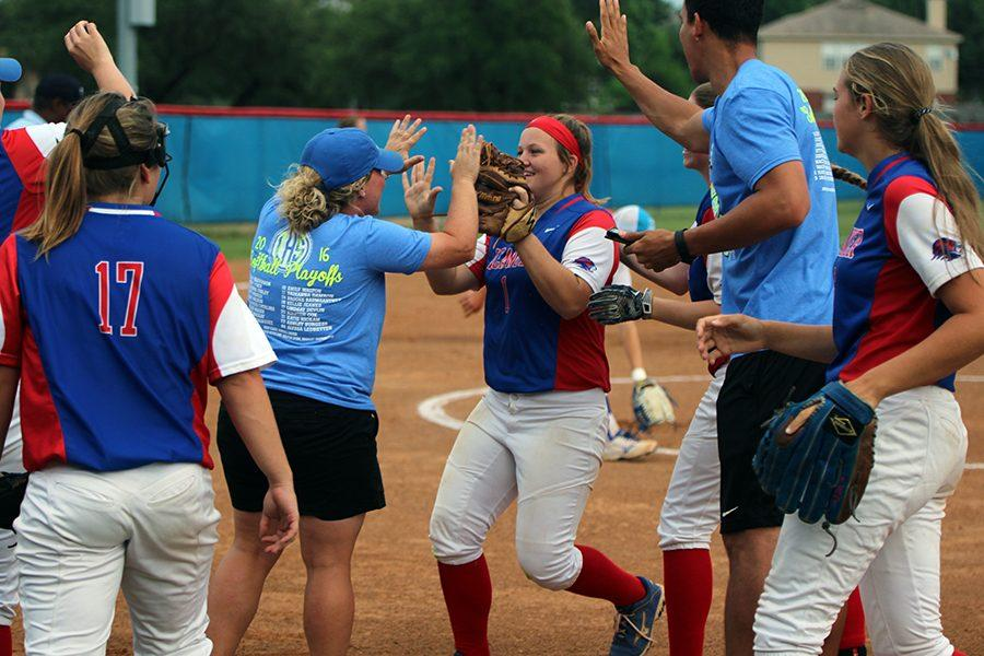 Head Coach Kendall Driver and freshman Haley Henderson celebrating after Henderson catches a fly ball.