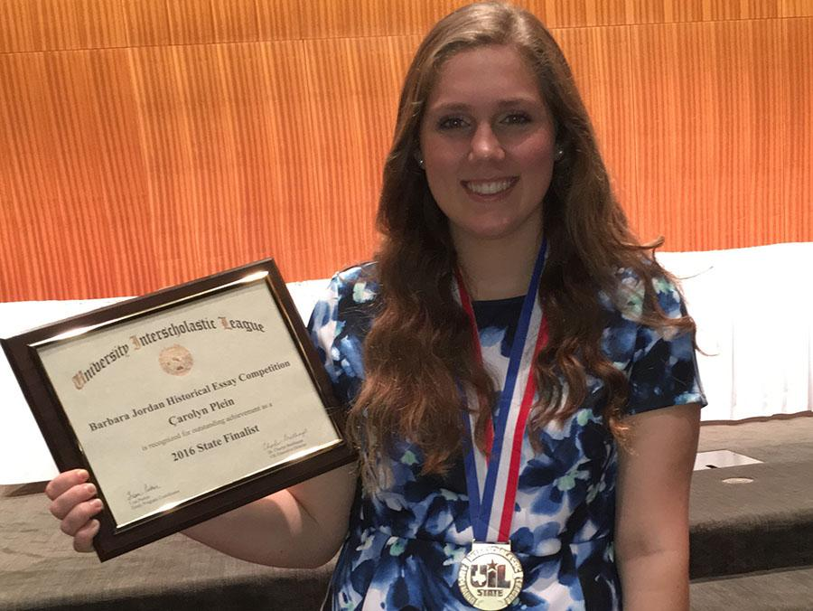 Carolyn Plein with her plaque and medal from winning first place at state for her essay. She also qualified for a scholarship.