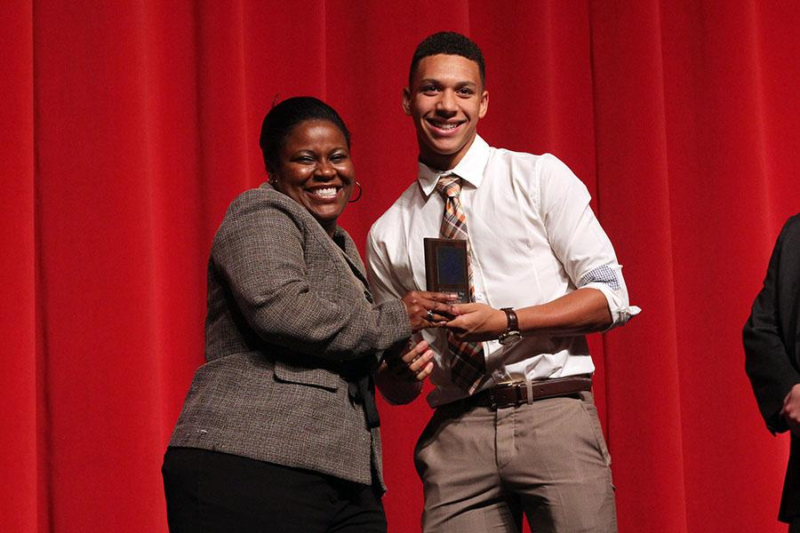 Doctor Spicer at the Senior Awards Ceremony posing with the Outstanding Boy of the year, Isaiah Turner.  She has been present at every school function she can possibly be at, in support of her students and faculty.