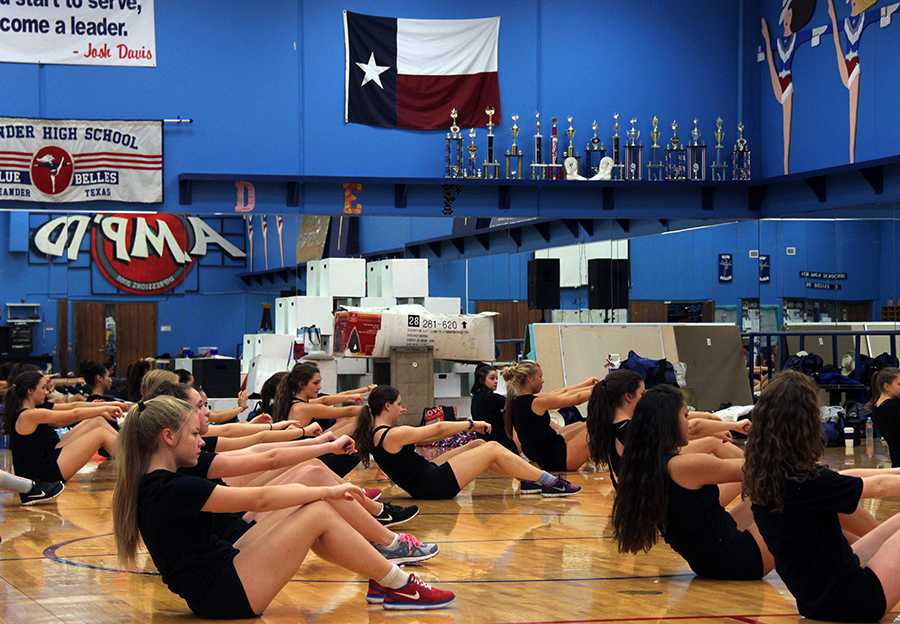 The Blue Belles doing different exercises and stretches during their camp 'Metamorphosis'. Their workouts are called 'go hard' workouts.