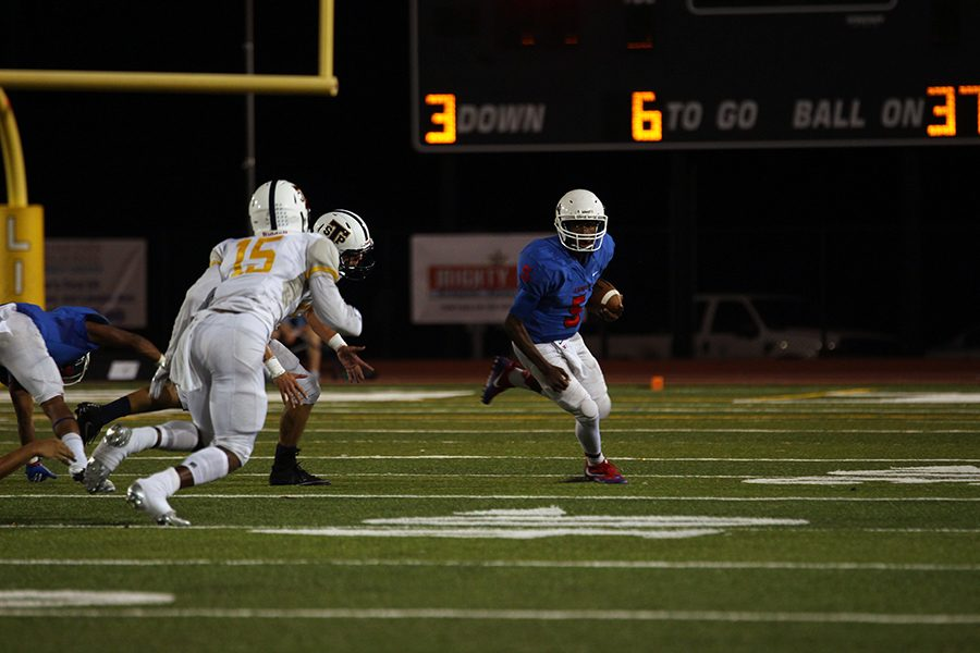 Sophomore Rashad Carter runs the ball against the Tigers. This is Carter's first game on varsity.