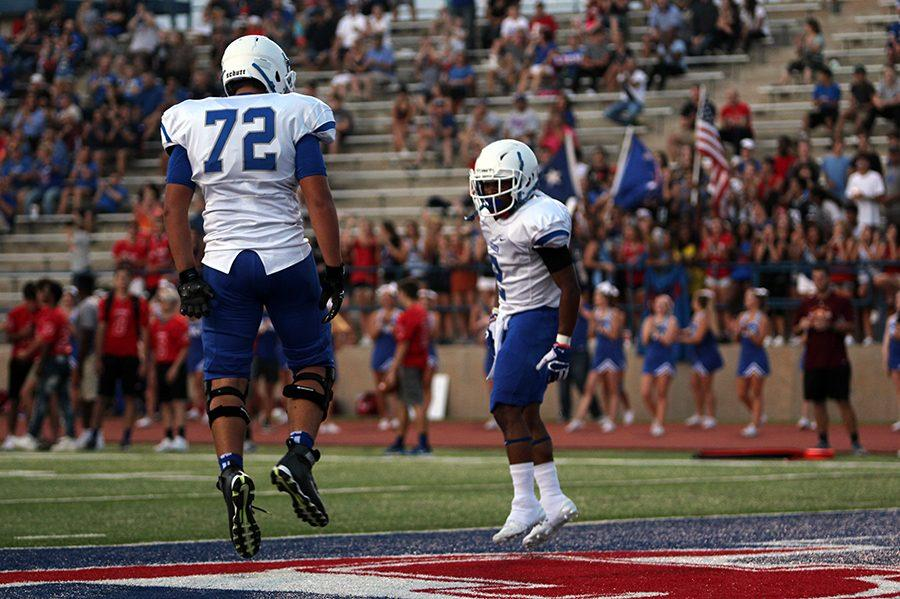 Senior Jai Garcia and junior Josh Long celebrate Garcia's touchdown. The touchdown tied the score at 7-7.