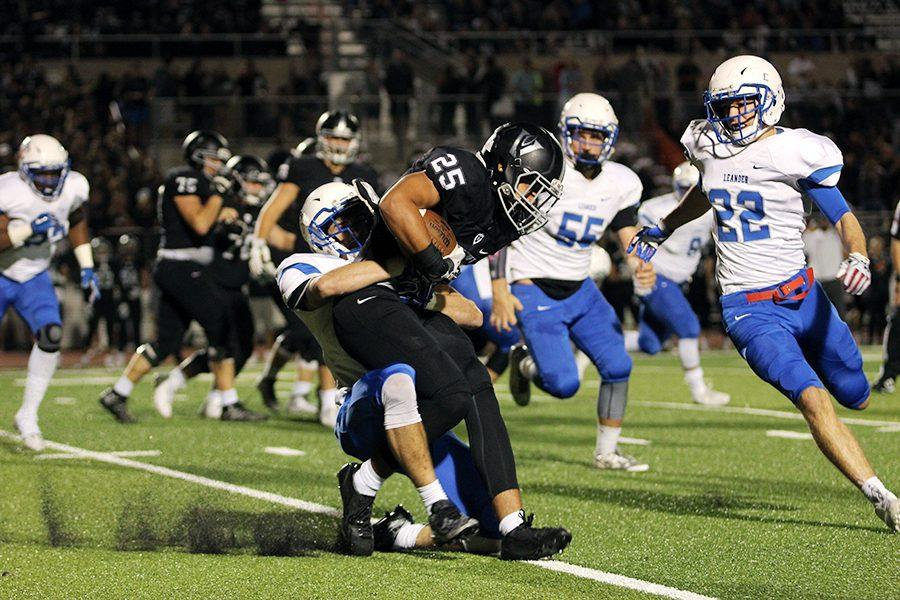 Junior Riley Harkleroad tackles a Vandegrift player. He had nine total tackles in the game.
