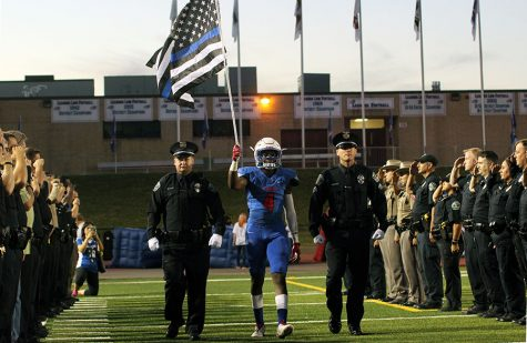 Senior Mati Abdul-Khaliq walks out during a tribute for his father Amir Abdul-Khaliq. It was held before the game.