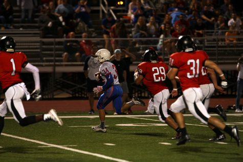 Sophomore running back Adison Larue rushes past the Vista line to score his first touchdown of the night. Larue scored both of the Lion touchdowns.