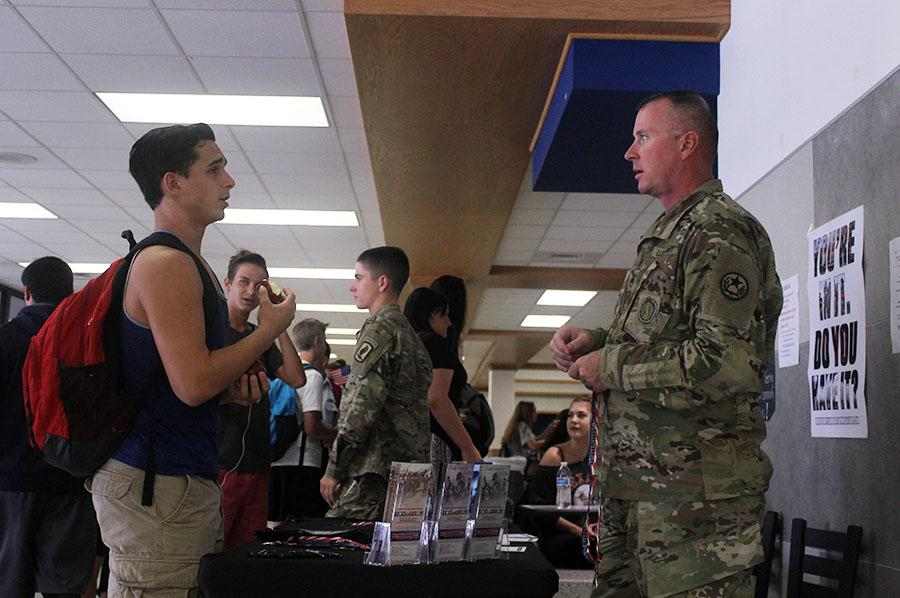 Staff Sergeant Munger talks to a student during lunch.  Munger is a recruiter for the National Guard and has also been in combat in Afghanistan.