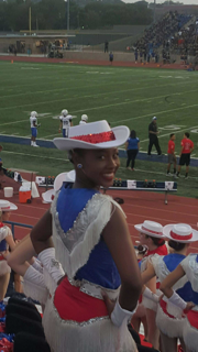 Ayanna Zachary poses while cheering on the lions. This is her first year on Blue Belles.