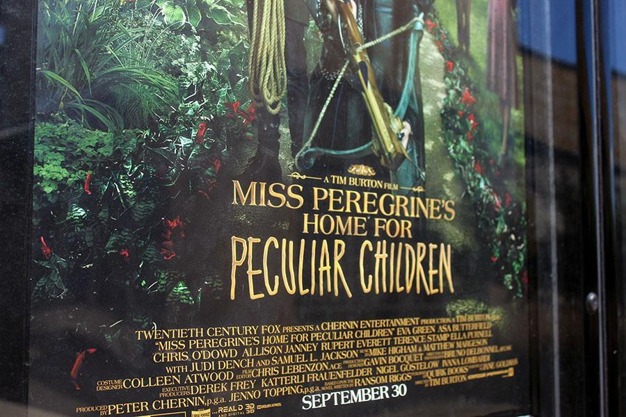 Movie poster displaying Miss Peregrine's Home for Peculiar Children in front of the Cinemark Cedar Park. Peregrine is the name of a certain type of falcon.