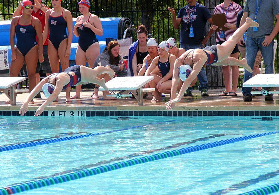 Two swimmers dive in at the East-view meet. The Lions have now moved on to Invitational meets, and will be attending TISCA this weekend.