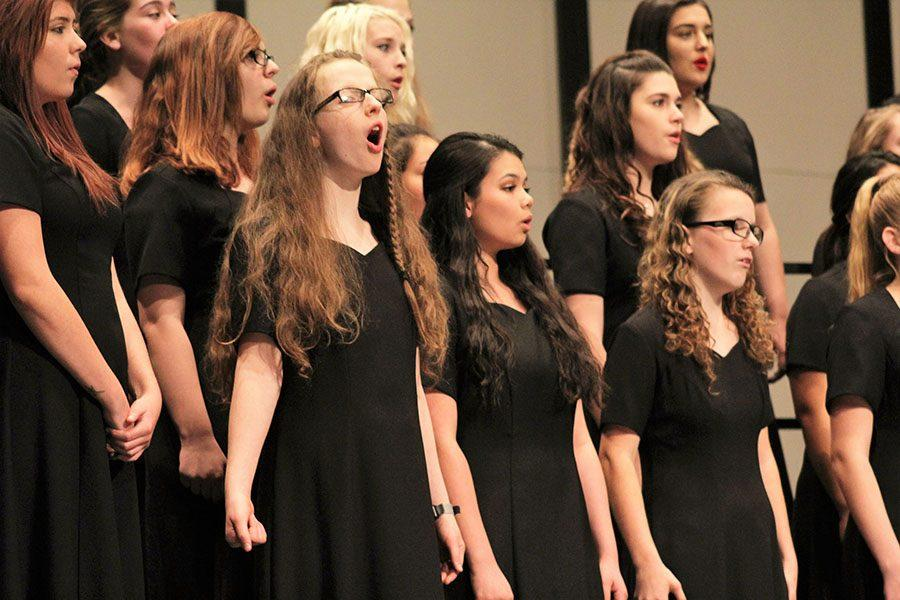 Women's choir singing at the annual holiday concert. This is the third concert Mr. Wiley has hosted.