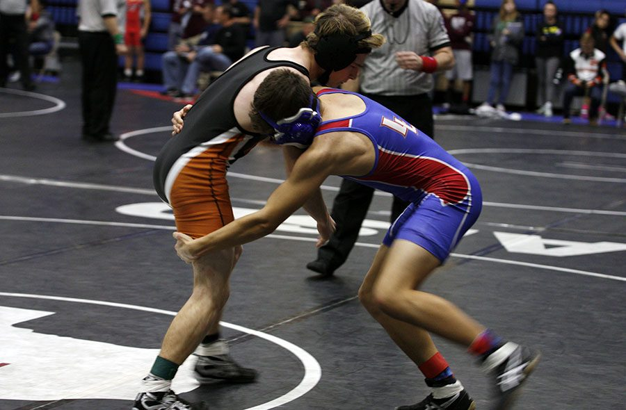 A wrestler starts his match at the Centex Invitational Tournament.