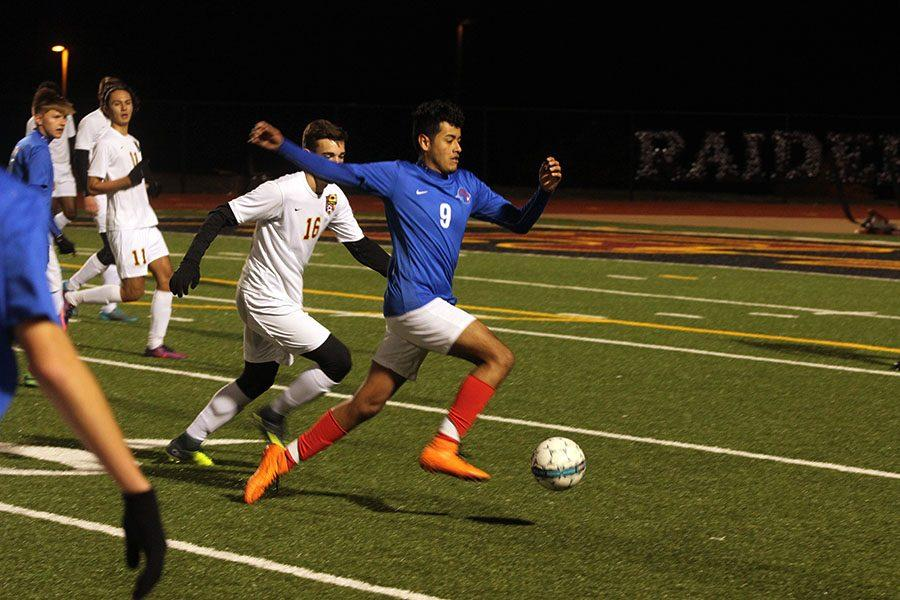 Senior Arturo Palomino looks to take the ball past a Rouse player. Junior Eduardo Escobedo was the only goalscorer for the Lions.