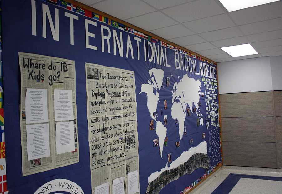 The IB wall outside of the nurse's office covered with information. It has the names of the current seniors in IB and where previous candidates have gone to college.