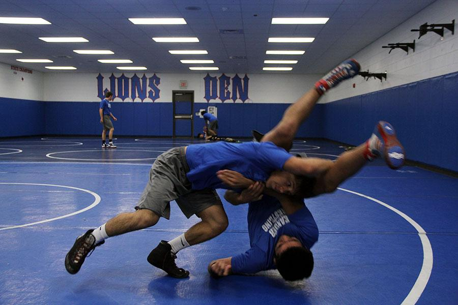 Senior Ricky Smith practices during the wrestling class. He got one of the wins during senior night.