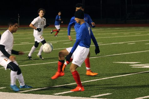 Sophomore Angel Ruiz flicks the ball past a Rouse defender. They lost this game 3-1.